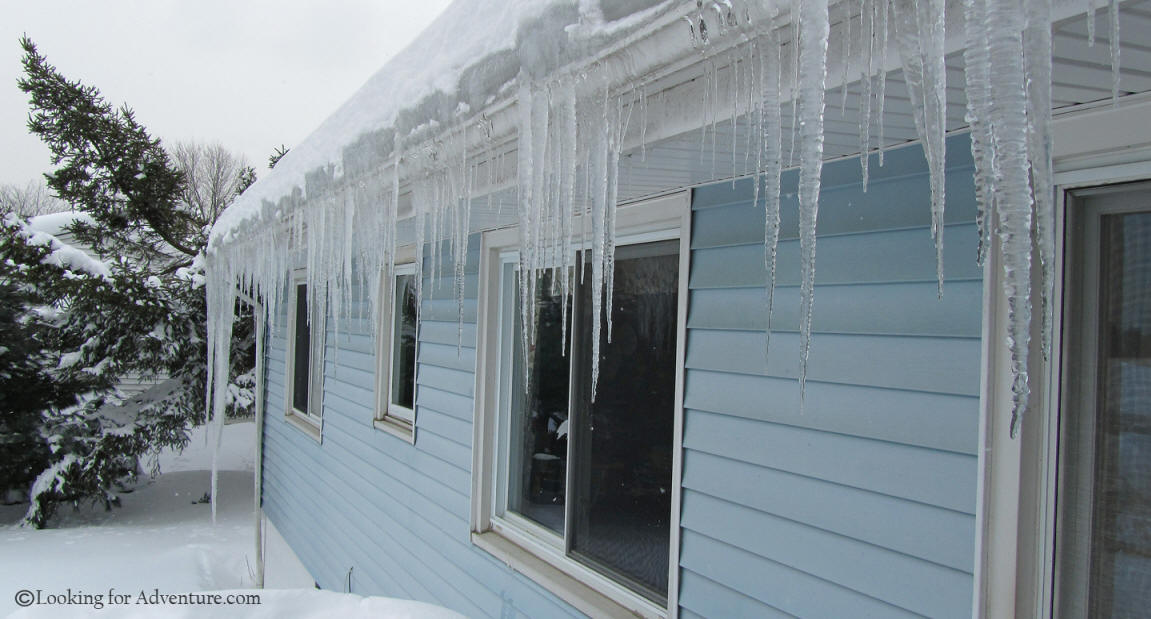 Icicles Hanging From A Gutter On A House In Danbury