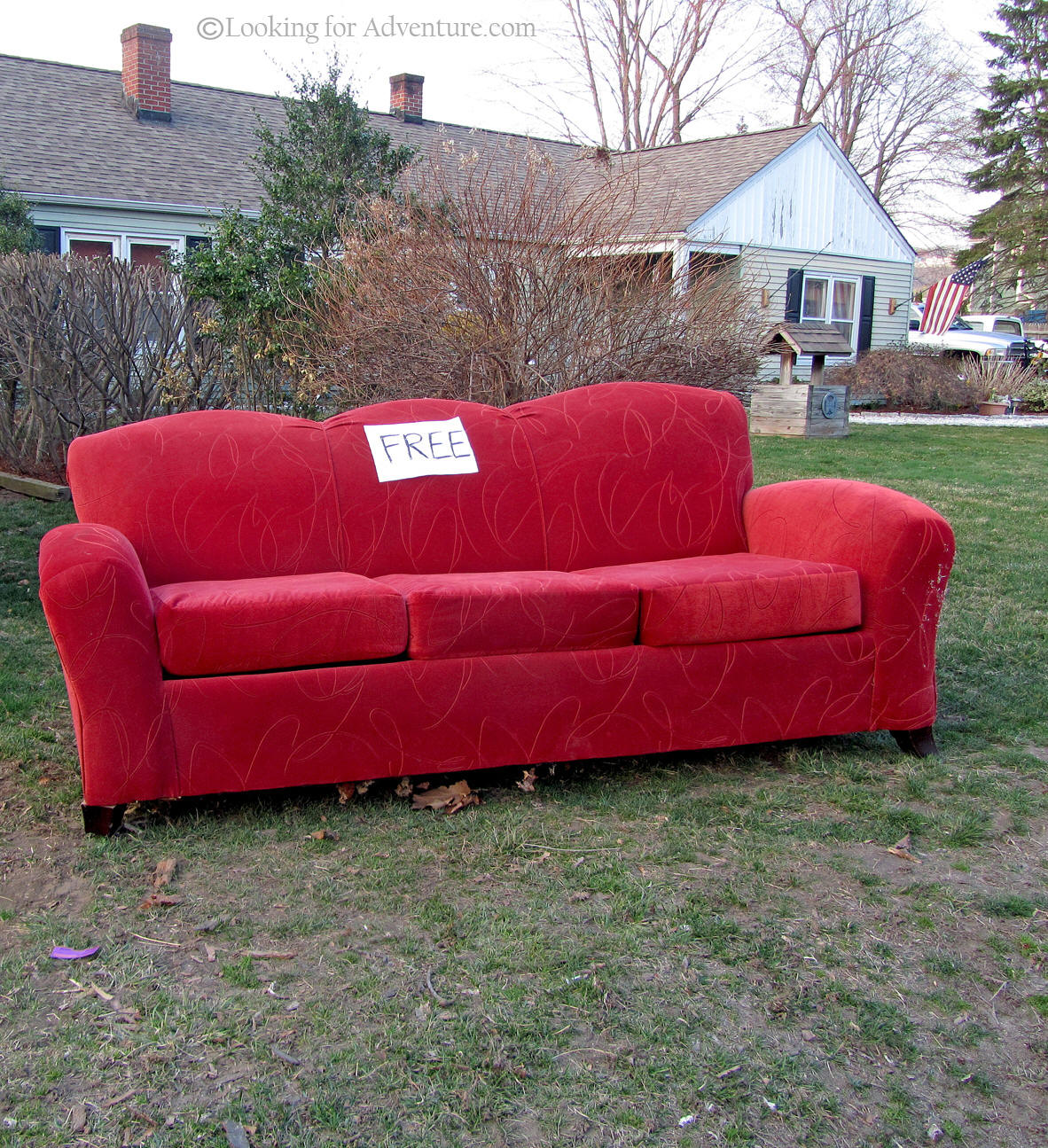 Roadside Red Couch Sofa Outside On The Front Lawn Of A House With A For Free  Sign